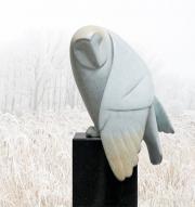 Opkijkende uil © Evert den Hartog