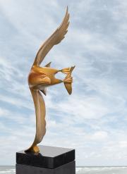 Roofvogel met vis © Evert den Hartog